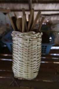 Chopsticks and spoons in basket