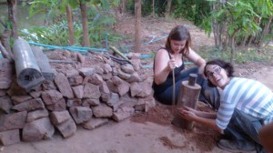 Preparing Foundation with sand and stones. Thanks to our volunteer, Sarah and Willow