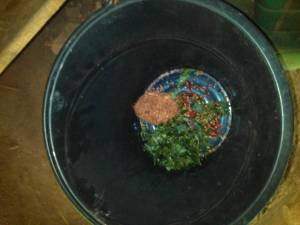 Place in pail and mix with water